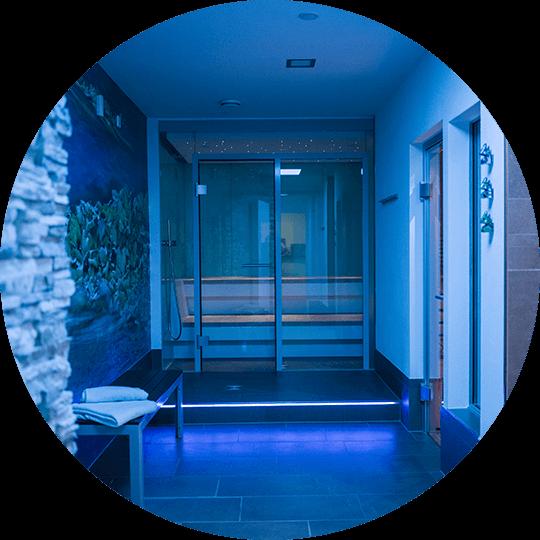 Blue illuminated wellness area with steam sauna in the Hotel Alexa Bad Mergentheim