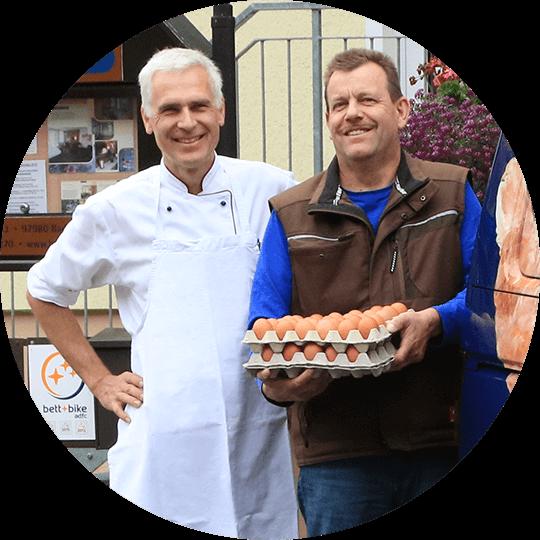 Chef Oliver Schulz with the regional egg supplier Mr. Neser